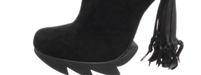 Reptilian tassel boots